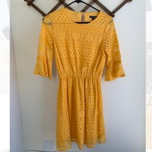Yellow lace dress with bell sleeves